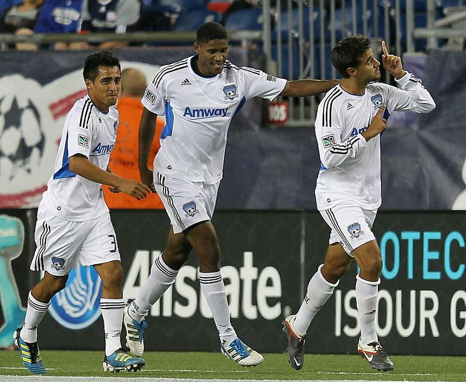 FOXBORO, MA - OCTOBER 8:  Chris Wondolowski #8 of the San Jose Earthquakes celebrates after scoring a goal with teammates Chris Leitch #3 and Khari Stephenson #7 against the New England Revolution at Gillette Stadium on October 8, 2011 in Foxboro, Massachusetts. (Photo by Jim Rogash/Getty Images) Photo: Jim Rogash, Getty Images