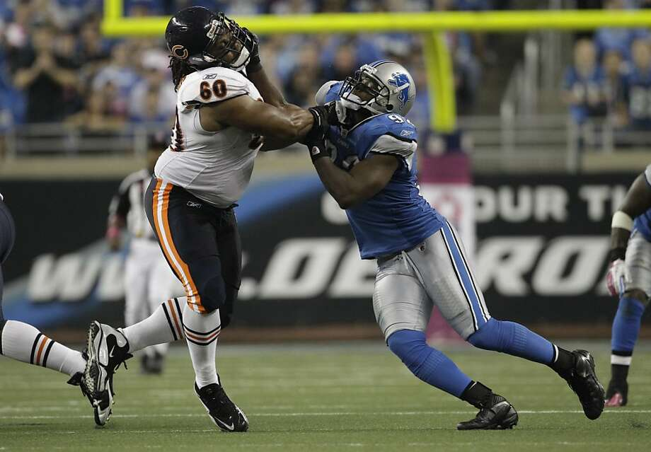 Detroit Lions defensive end Cliff Avril (92) rushes Chicago Bears offensive guard Lance Louis (60) in the fourth quarter of NFL football game in Detroit, Monday, Oct. 10, 2011.  (AP Photo/Paul Sancya) Photo: Paul Sancya, AP