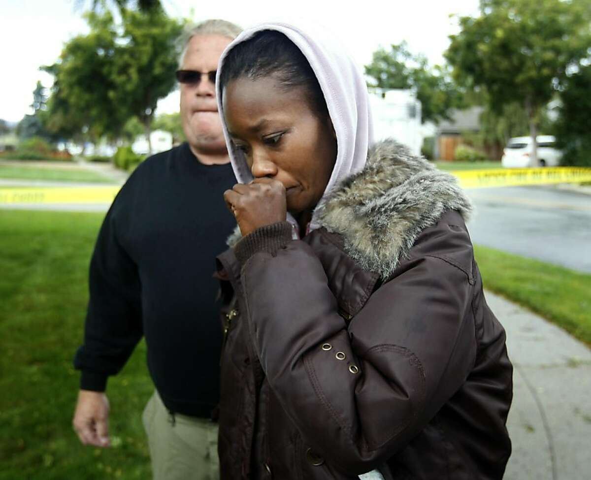 Octavia Bernard, who says she is a friend of shooting suspect Shareef Allman, arrives at a crime scene on Lorne Way after police officers reportedly shot and killed Allman during a shootout in Sunnyvale, Calif. on Thursday, Oct. 6, 2011. Allman is suspected of gunning down several co-workers in Cupertino, killing three, and later shooting a woman who he attempted a to carjack on Wendesday.