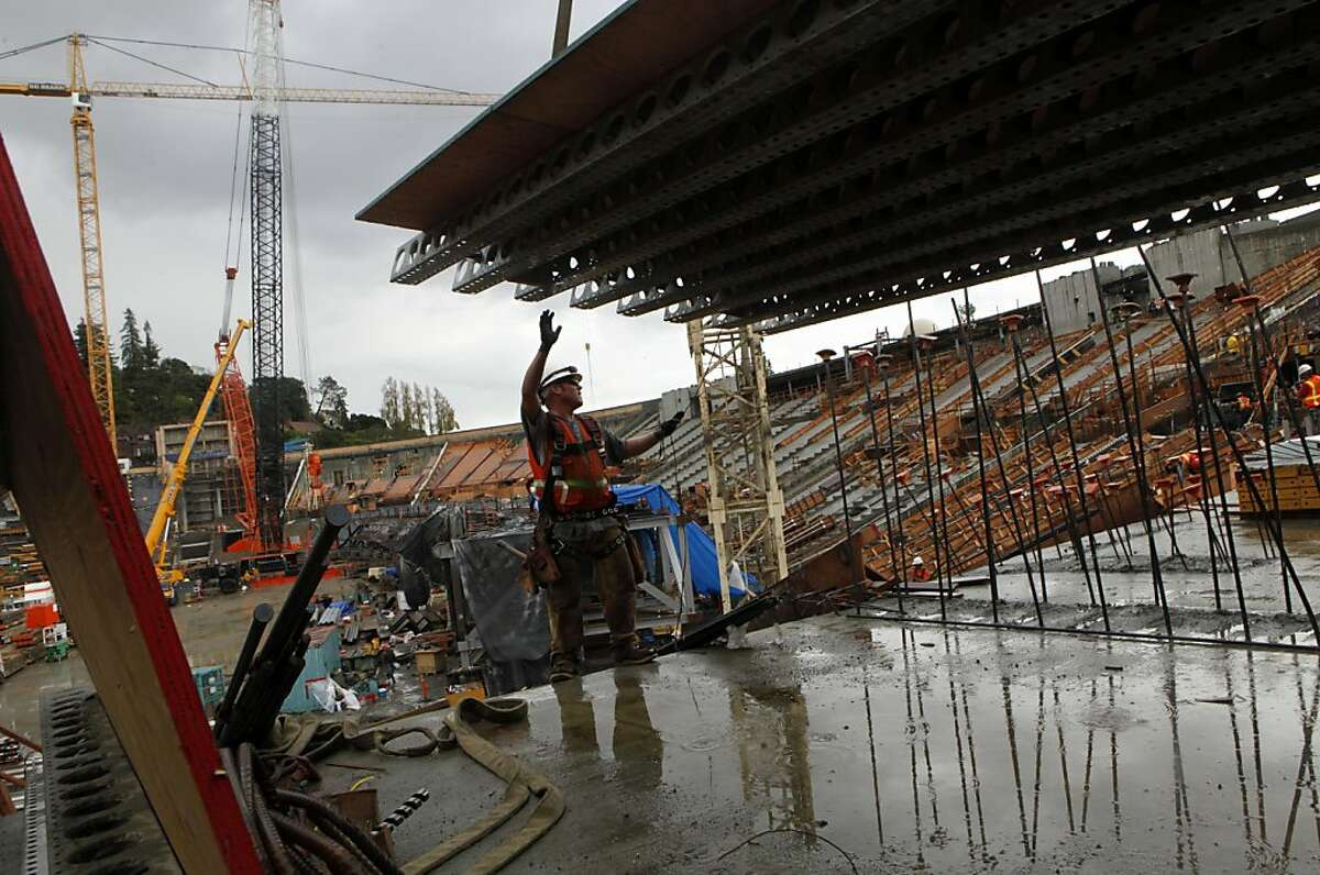 Mike Armstrong a ironworker-rigger pushed off a modular floor assembly , while working on the renovation of California Memorial Stadium Wednesday October 5, 2011.