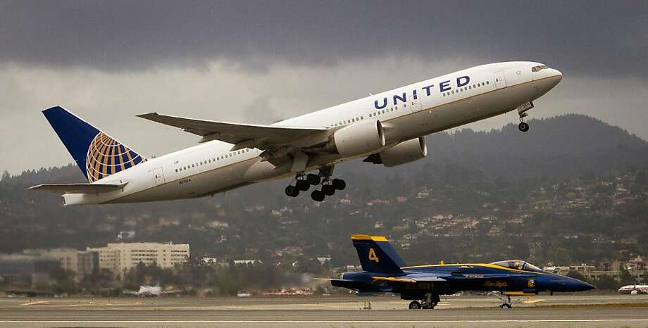 A United jet takes off as a Blue Angel taxis into San Francisco International  Airport in San Francisco, Calif., on Wednesday, October 5, 2011. Photo: John Storey, Special To The Chronicle