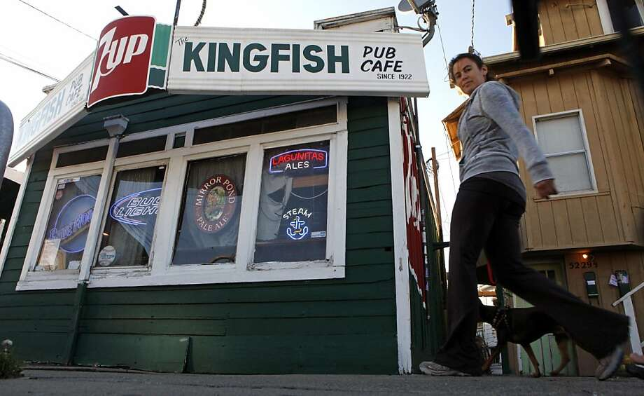 Pedestrians have been walking past the Kingfish for decades. Emil Peinert owner of the Kingfish pub and Cafe has filed to make his very beloved watering hole a Oakland landmark Thursday October 6, 2011. Photo: Lance Iversen, The Chronicle