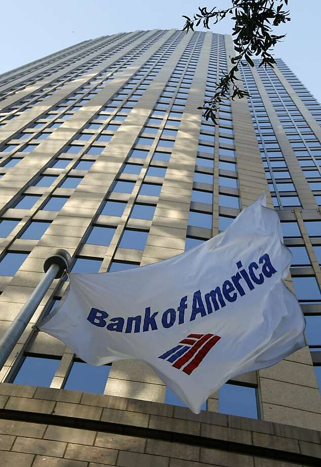 A flag flies in front of Bank of America's corporate headquarters in Charlotte, N.C., Wednesday, Oct. 5, 2011. Bank of America still isn't explaining why customers may be having trouble signing into their accounts.(AP Photo/Chuck Burton) Photo: Chuck Burton, AP