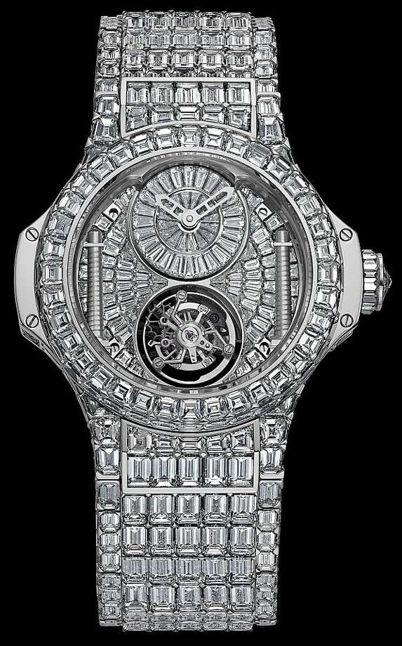 A diamond-encrusted, Big Bang wrist-watch, produced by Hublot, is seen in this handout photograph released to the media in London, U.K., on Tuesday, Oct. 4, 2011. The Swiss brand, which sold a $3 million diamond-laden Big Bang model within a day this year, aims to up the ante by creating its most expensive timepiece ever, encrusting it with as many as 300 carats of diamonds as it works to grab the attention of its newest target market: ladies' watches. Source: Hublot via Bloomberg EDITOR'S NOTE: NO SALES. EDITORIAL USE ONLY A diamond-encrusted, Big Bang wrist-watch, produced by Hublot, is seen in this handout photograph released to the media in London, U.K., on Tuesday, Oct. 4, 2011. The Swiss brand, which sold a $3 million diamond-laden Big Bang model within a day this year, aims to up the ante by creating its most expensive timepiece ever, encrusting it with as many as 300 carats of diamonds as it works to grab the attention of its newest target market: ladies' watches. Source: Hublot via Bloomberg EDITOR'S NOTE: NO SALES. EDITORIAL USE ONLY Photo: Hublot, Bloomberg News