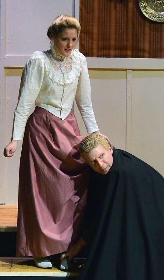 """The elcherous poet Versati (Paul Stout) helps the seamstress by measuring Louise's  (Riley Krull) inseam in Steve Martin's """"The Underpants"""" at Custom Made Theatre Photo: Jay Yamada"""