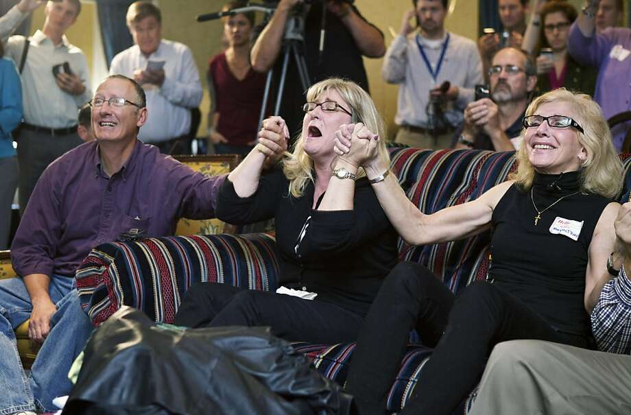 SEATTLE, WASHINGTON  - OCTOBER:  Supporters of Amanda Knox (L to R) John Lang, Kellanne Henry and Margaret Ralph celebrate in a hotel after an Italian jury overturned of Knox's conviction for killing British student Meredith Kercher October 3, 2011 in Seattle Washington. Knox will be freed along with her co-defendant Raffaele Sollecito after their 2009 concviction. The slander charges against the two were upheld.  (Photo by Stephen Brashear/Getty Images) Photo: Stephen Brashear, Getty Images