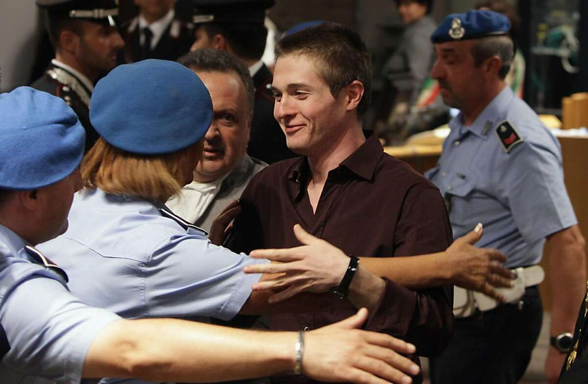Raffaele Sollecito is congratulated in Perugia's Court of Appeal after hearing that he won his appeal against his murder conviction on October 3, 2011 at Perugia's court. US Amanda Knox was acquitted of murder and sexual assault by an Italian appeal court on Monday after four years in custody over the killing of her British housemate Meredith Kercher. AFP PHOTO /POOL/ Oli Scarff (Photo credit should read OLI SCARFF/AFP/Getty Images)