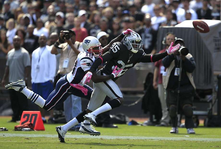 Oakland Raiders defensive back Chimdi Chekwa (35) breaks up a pass intended for New England Patriots wide receiver Matthew Slater (18) during an NFL football game in Oakland, Calif., Sunday, Oct. 2, 2011. (AP Photo/Marcio Jose Sanchez) Photo: Marcio Jose Sanchez, AP