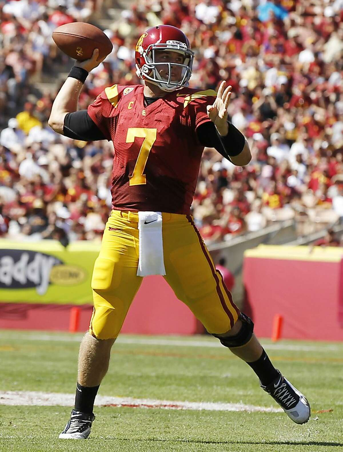 Southern California quarterback Matt Barkley throws a touchdown pass to tight end Xavier Grimble against Arizona during the first half of an NCAA college football game Saturday, Oct. 1, 2011, in Los Angeles. (AP Photo/Danny Moloshok)