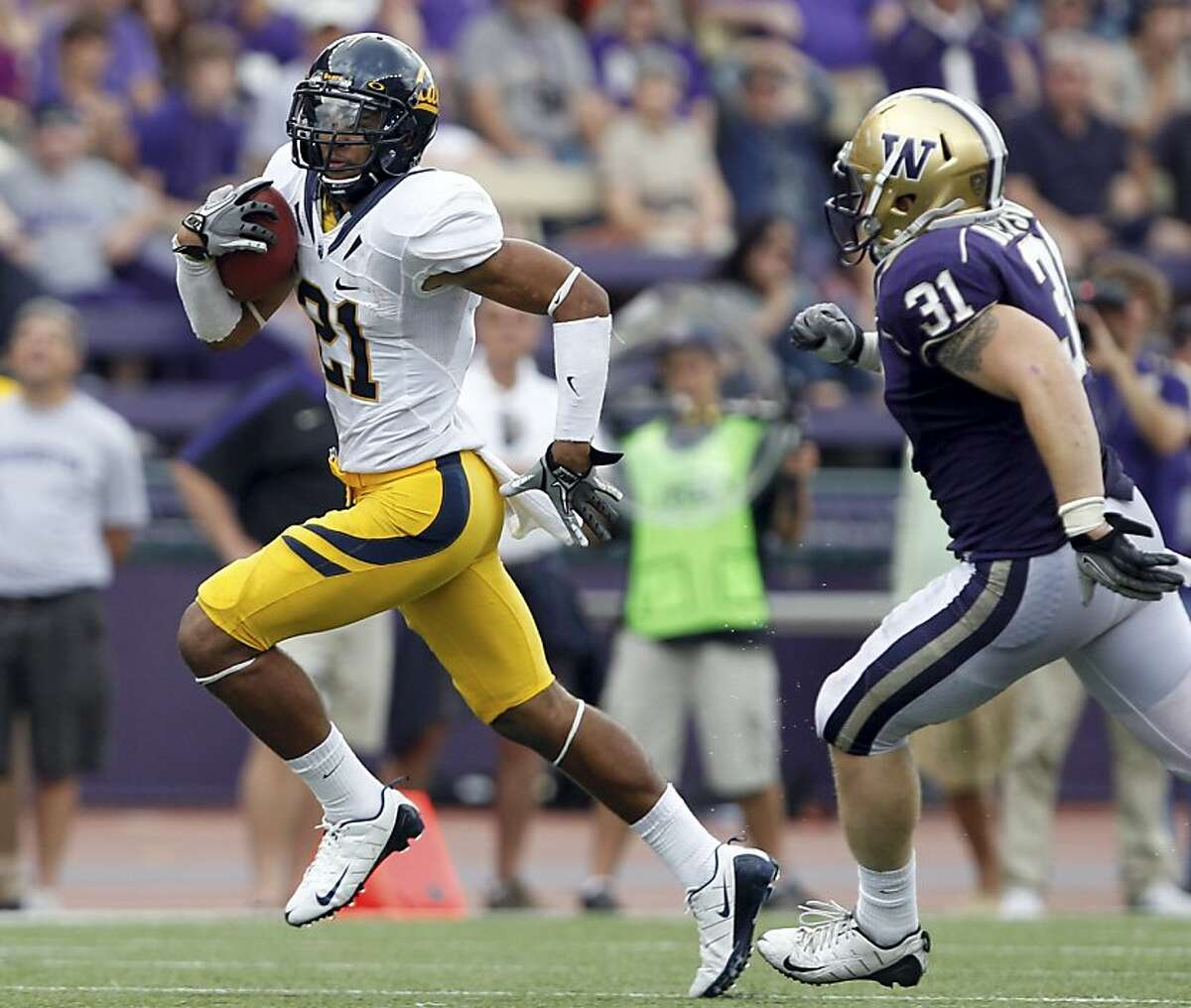California's Keenan Allen, left, is chased by Washington's Cort Dennison in the second half of an NCAA college football game, Saturday, Sept. 24, 2011, in Seattle. Washington won 31-23. (AP Photo/Elaine Thompson)