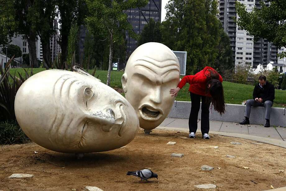 """Robert Arneson's """"Yin and Yang"""" sculpture with Sue Bierman Park in the background in the Embarcadero in San Francisco, California, on Tuesday, October 4, 2011. Photo: Liz Hafalia, The Chronicle"""