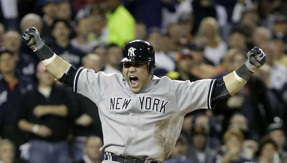 New York Yankees' Russell Martin reacts after scoring on a Derek Jeter double to center field during the third inning of Game 4 of baseball's American League division series against the Detroit Tigers on Tuesday, Oct. 4, 2011, in Detroit. (AP Photo/Paul Sancya) Photo: Paul Sancya, AP