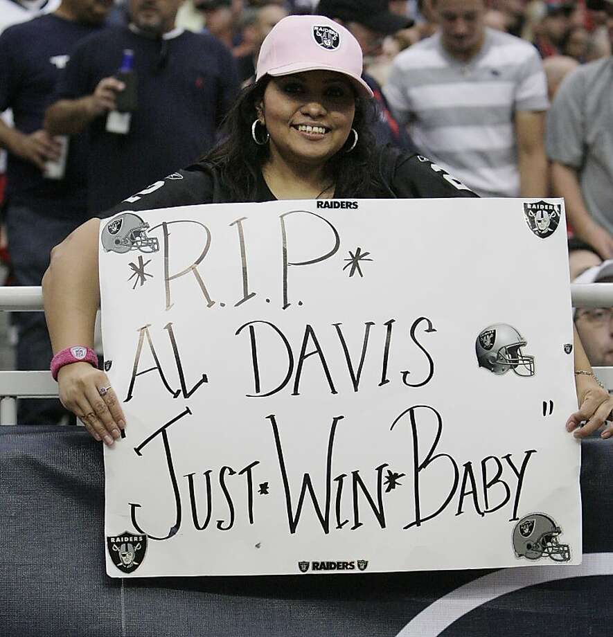 HOUSTON - OCTOBER 09:  Fans show their respects to Oakland Raiders owner Al Davis during a football game at Reliant Stadium on October 9, 2011 in Houston, Texas.  (Photo by Bob Levey/Getty Images) Photo: Bob Levey, Getty Images