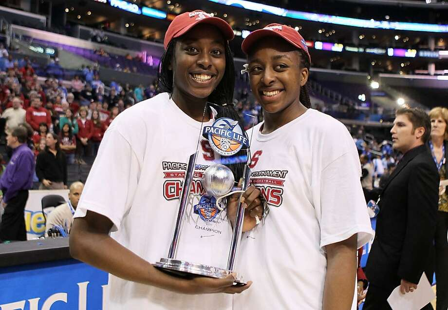 LOS ANGELES, CA - MARCH 12:  (L-R) Chiney Ogwumike #13 and Nnemkadi Ogwumike #30 of the Stanford Cardinal celebrate after the Cardinal defeat the UCLA Bruins 64-55 to win in the championship game of the 2011 Pacific Life Pac-10 Women's Basketball Tournament at Staples Center on March 12, 2011 in Los Angeles, California.  (Photo by Jeff Gross/Getty Images)  Ran on: 04-03-2011 The Ogwumike sisters had that championship feeling after Stanford won the Pac-10 tournament title. Photo: Jeff Gross, Getty Images