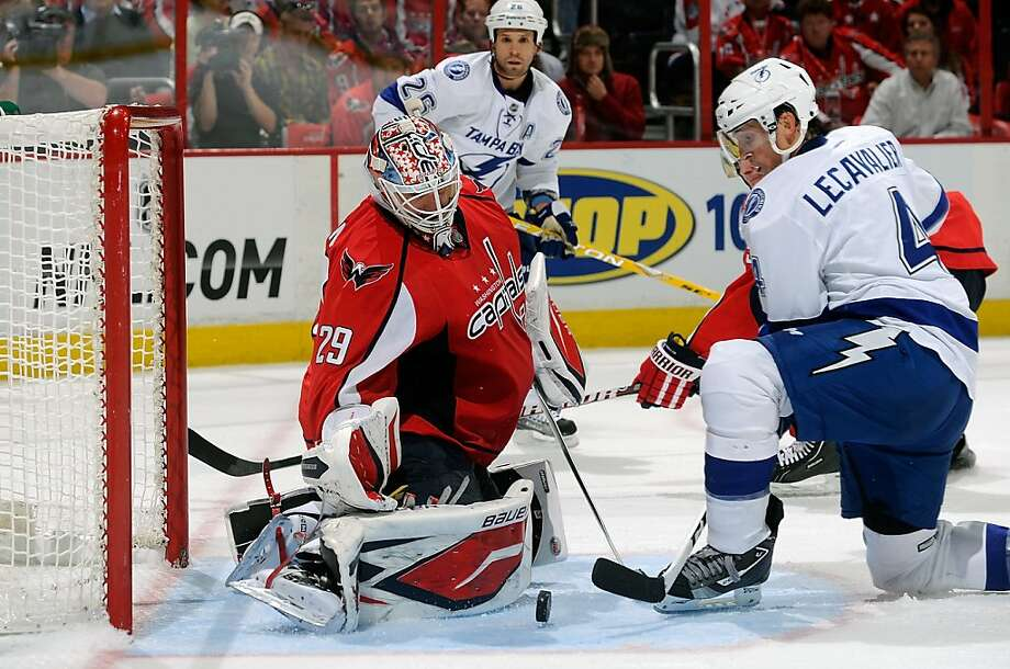 WASHINGTON, DC - OCTOBER 10:  Tomas Vokoun #29 of the Washington Capitals makes a save in overtime against Vincent Lecavalier #4 of the Tampa Bay Lightning at the Verizon Center on October 10, 2011 in Washington, DC.  The Capitals won the game 6-5.  (Photo by Greg Fiume/Getty Images) Photo: Greg Fiume, Getty Images