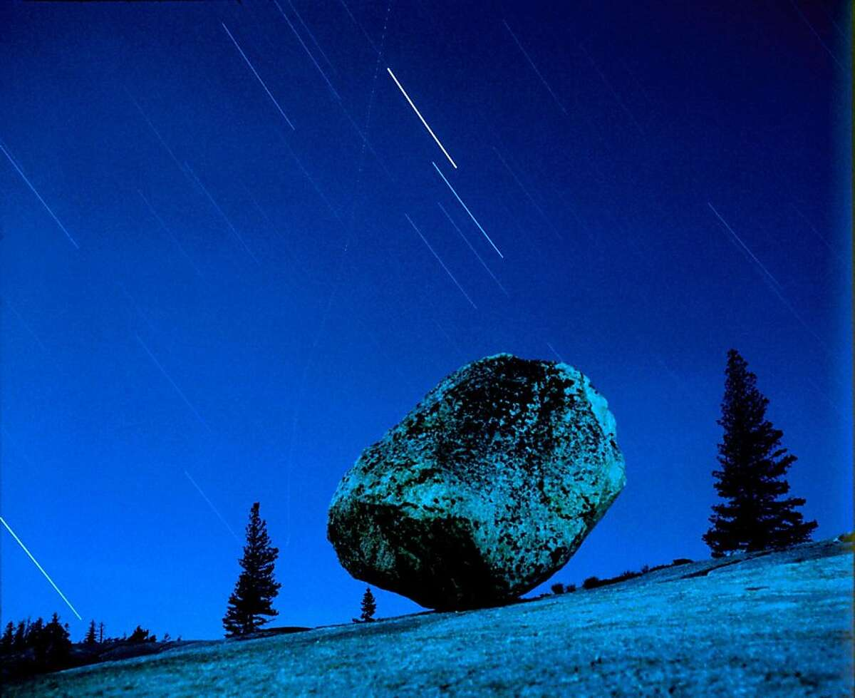 """Steve's Rock, Olmstead Point, Yosemite National Park - Steve Harper (1981) In his early experiments with night photography, Steve Harper often spent whole nights alone, meditatively shooting natural and urban landscapes under cover of darkness. During these all-night sessions, """"I'm totally peaceful, yet alert,"""" says Harper."""