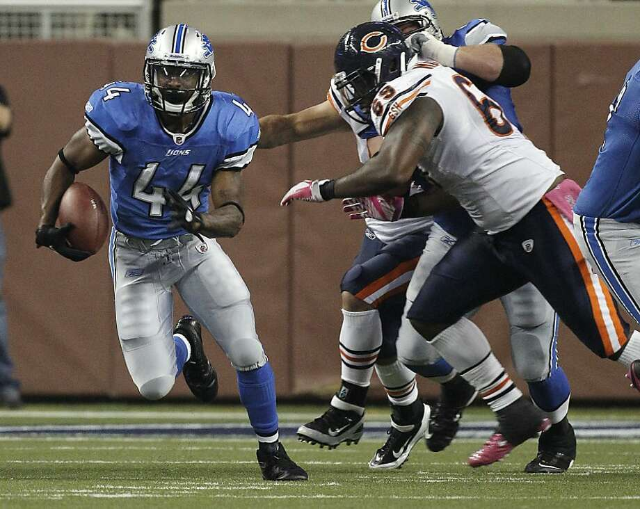 Detroit Lions running back Jahvid Best (44) breaks away from Chicago Bears defensive tackle Henry Melton (69) for an 88-yard touchdown run during the third quarter of an NFL football game in Detroit, Monday, Oct. 10, 2011. (AP Photo/Carlos Osorio) Photo: Carlos Osorio, AP