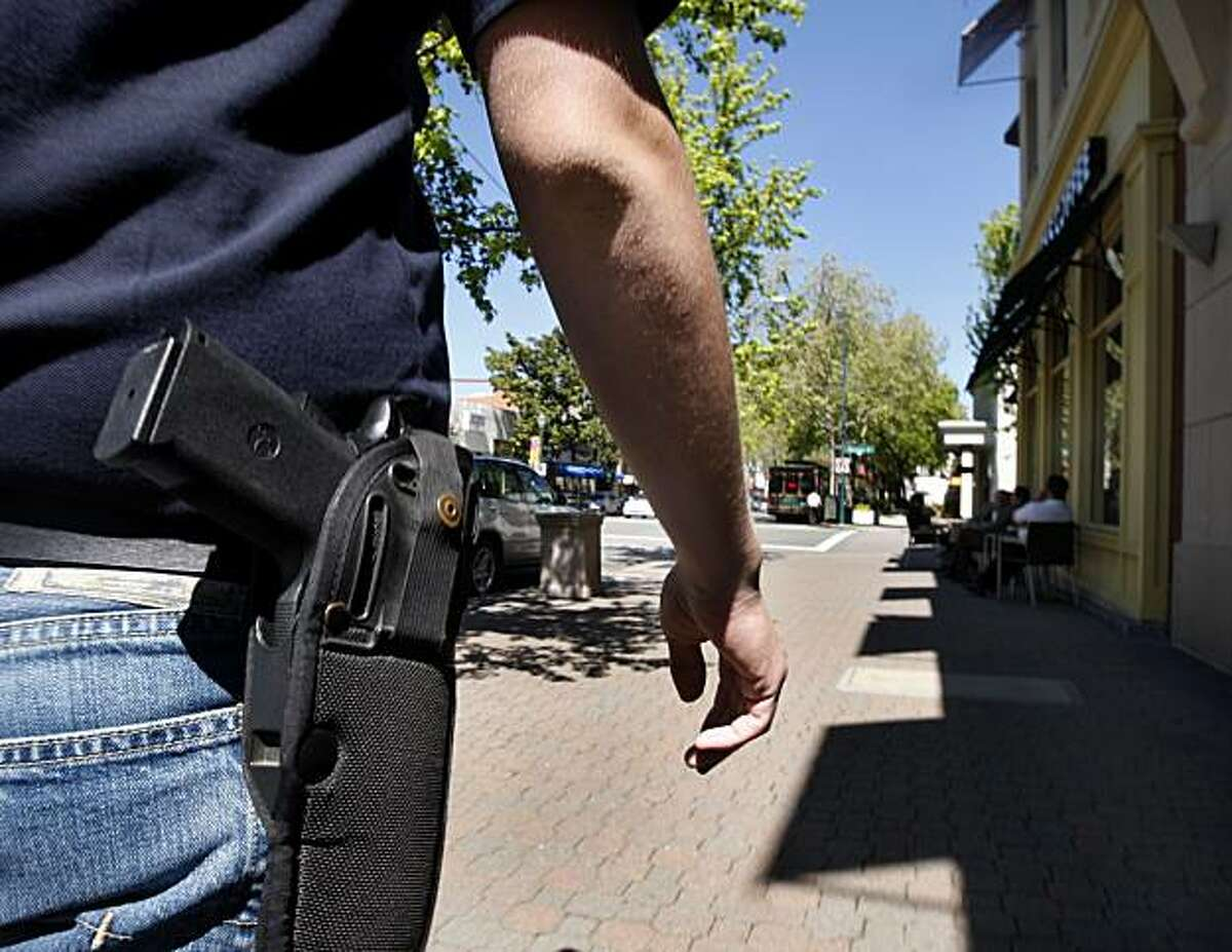 Brad Huffman wears his .45 caliber handgun while walking on North Main Street in downtown Walnut Creek, Calif., on Wednesday, April 7, 2010. Huffman is among a growing number of gun owners that are advocating the