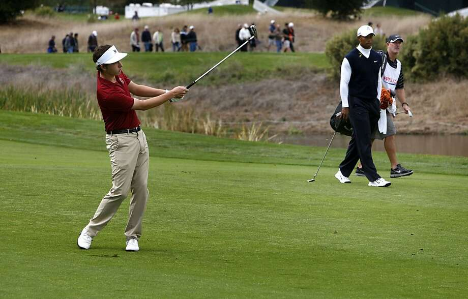 US amateur champion Patrick Cantlay hits his approach shot to the 9th hole as his playing partner, Tiger Woods passes by, as round 1 of the Frys.com Open gets underway at the CordeValle Golf Club in San Martin, Ca. on Thursday October 6, 2011. Photo: Michael Macor, The Chronicle