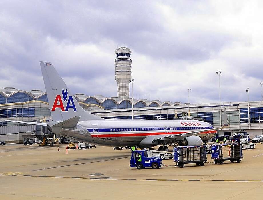 "(FILES)An American Airlines jet sits at the terminal at Ronald Reagan Washington National Airport in Washington, DC on September 12, 2009. Rumors that American Airlines parent AMR Corp would file for bankruptcy protection sent the company's stocks plummeting October 3, 2011. At 1745 GMT, the stock was down 34.1 percent to $1.95, as the airline, continued to struggle with a high debt load and sluggish demand growth, according to analysts. Morningstar analyst Basili Alukos said the selling comes after an ""abnormal"" number of pilot retirements in the past two months, with the pilots seeking to sell off their own stocks in the company out of fears it would fail.  AFP PHOTO/Karen BLEIER/FILES (Photo credit should read KAREN BLEIER/AFP/Getty Images) Photo: Karen Bleier, AFP/Getty Images"