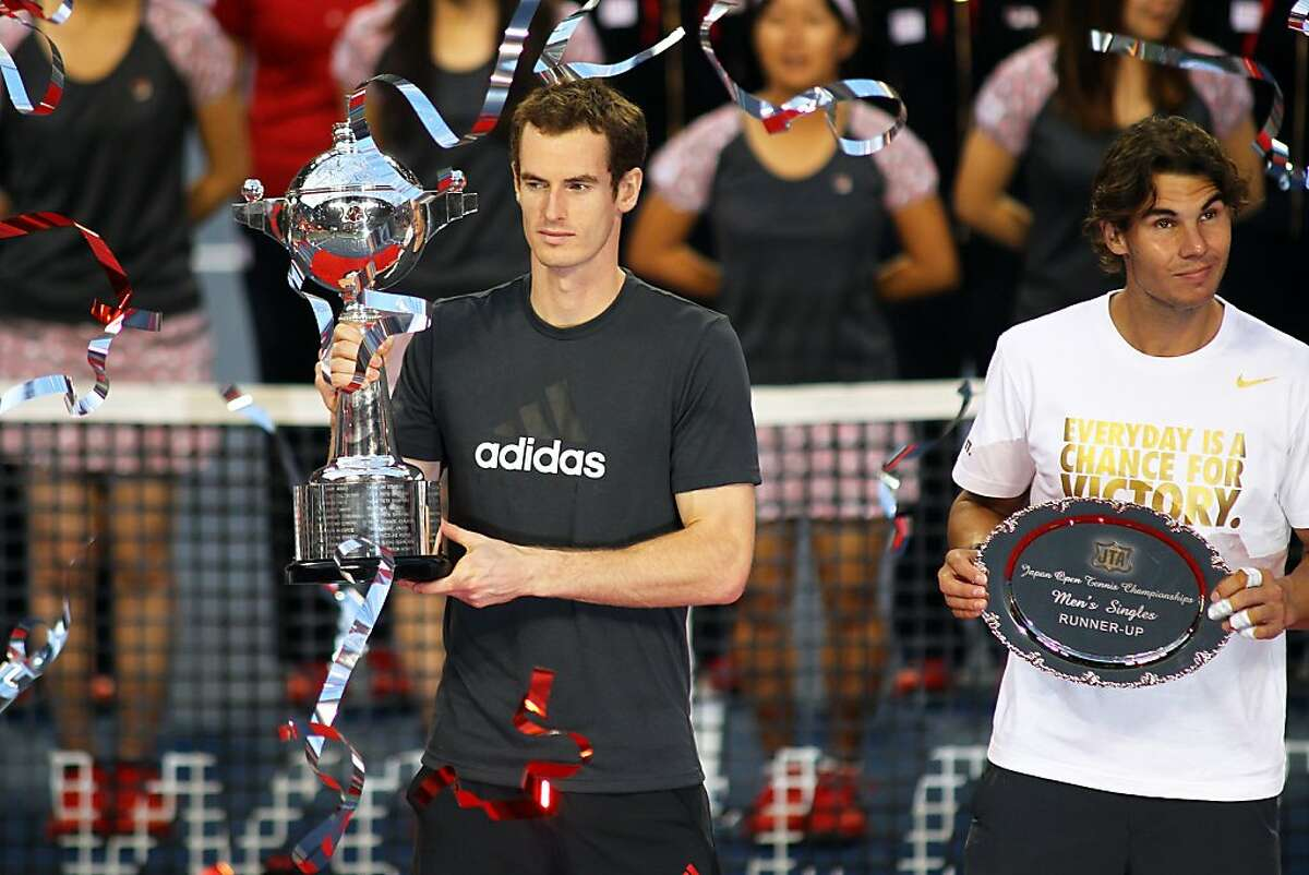 TOKYO, JAPAN - OCTOBER 09: Andy Murray (L) of Great Britain and Rafael Nadal of Spain pose with the trophies after in the men`s final match against during the day seven of the Rakuten Open at Ariake Colosseum on October 9, 2011 in Tokyo, Japan. (Photo by Koji Watanabe/Getty Images)