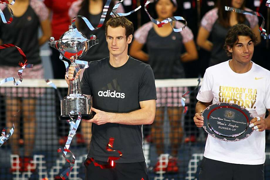 TOKYO, JAPAN - OCTOBER 09: Andy Murray (L) of Great Britain and  Rafael Nadal of Spain pose with the trophies after in the men`s final match against  during the day seven of the Rakuten Open at Ariake Colosseum on October 9, 2011 in Tokyo, Japan. (Photo by Koji Watanabe/Getty Images) Photo: Koji Watanabe, Getty Images