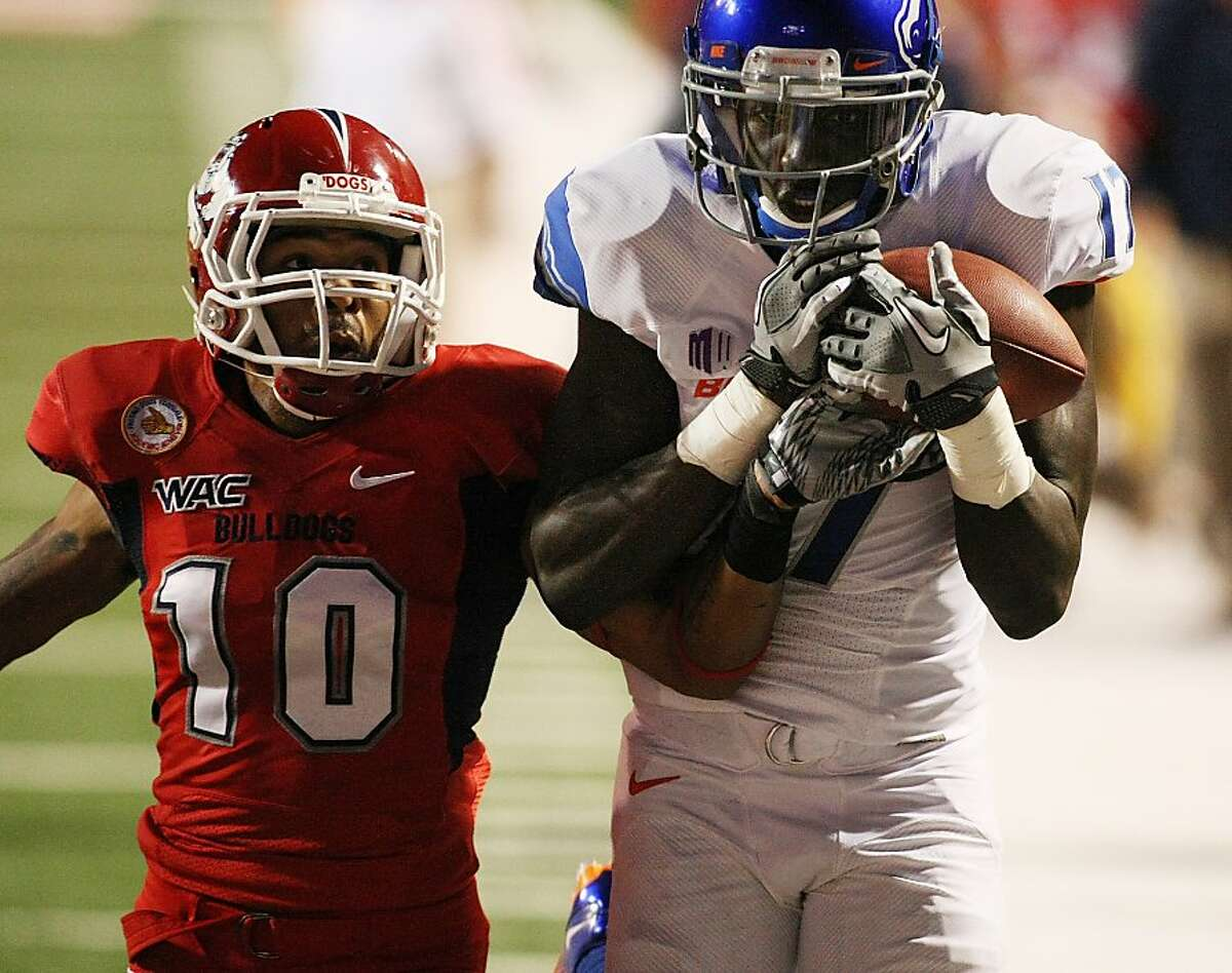 Boise State's Geraldo Boldewijn, right, catches a touchdown pass over Fresno State's Isaiah Green in the first half of an NCAA college football game on Friday, Oct. 7, 2011, in Fresno, Calif. (AP Photo/Gary Kazanjian)