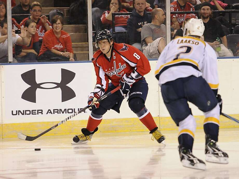 Alex Ovechkin, of Russia, (8) skates with the puck against Nashville Predators Teemu Laakso, of Finland, right, during the second period of an NHL preseason hockey game, Tuesday, Sept. 20, 2011, in Baltimore. (AP Photo/Nick Wass) Photo: Nick Wass, AP