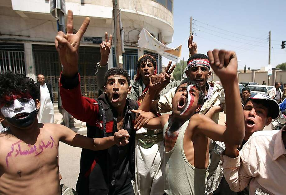 Yemeni anti-government protesters chant slogans and flash the victory sign during a demonstration calling for the regime's ouster in Sanaa on October 6, 2011. AFP PHOTO/MOHAMMED HUWAIS (Photo credit should read MOHAMMED HUWAIS/AFP/Getty Images) Photo: Mohammed Huwais, AFP/Getty Images