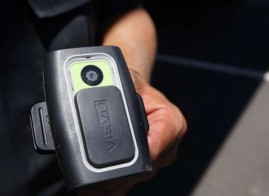 Brentwood police officer George Aguirre adjusts a digital video camera before his traffic enforcement patrol in Brentwood, Calif., on Wednesday, July  21, 2010. Aguirre has been using the micro video recording gear, which is about the size of a garage door opener, for over two years and wears it on his uniform during his shift. Photo: Paul Chinn, The Chronicle