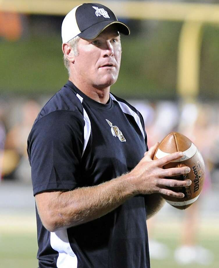 Oak Grove volunteer coach Brett Favre, former NFL quarterback, holds a football on the sidelines as they take on Petal during their high school football game, Friday, Sept. 30, 2011, in Hattiesburg Miss. (AP Photo/ Hattiesburg American, Ryan Moore)  Ran on: 10-06-2011 Photo caption Dummy text goes here. Dummy text goes here. Dummy text goes here. Dummy text goes here. Dummy text goes here. Dummy text goes here. Dummy text goes here. Dummy text goes here.###Photo: names06_PHfavre1317254400Ryan Moore- Hattiesburg American###Live Caption:Oak Grove volunteer coach Brett Favre, former NFL quarterback, holds a football on the sidelines as they take on Petal during their high school football game, Friday, Sept. 30, 2011, in Hattiesburg Miss.###Caption History:Oak Grove volunteer coach Brett  Ran on: 10-08-2011 {hellip} but Brett Favre says he meant no disrespect toward Aaron Rodgers. Ran on: 10-08-2011 {hellip} but Brett Favre says he meant no disrespect toward Aaron Rodgers. Photo: Ryan Moore, AP