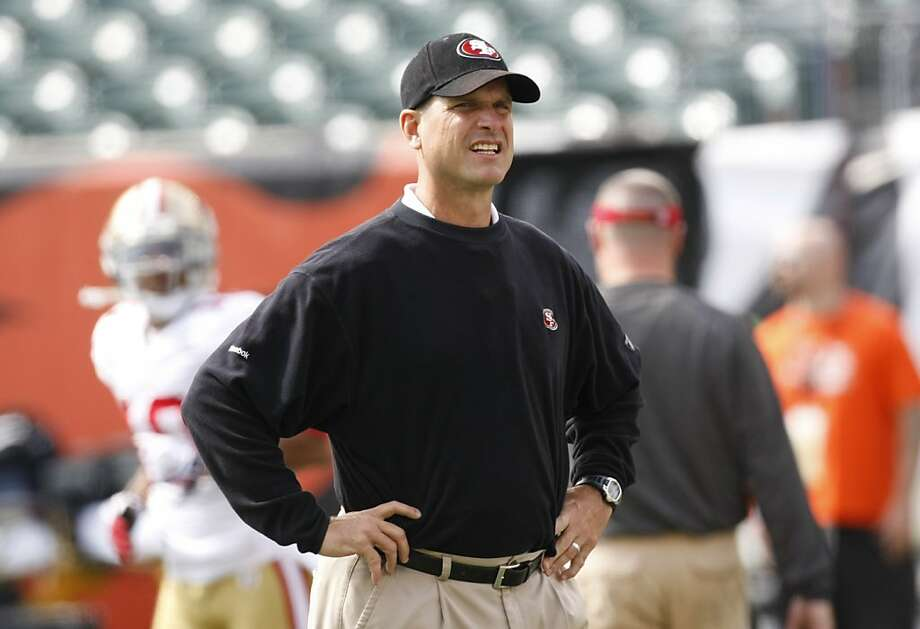 San Francisco 49ers head coach Jim Harbaugh warms up prior to an NFL football game against the Cincinnati Bengals  Sunday, Sept. 25, 2011, in Cincinnati. (AP Photo/Ed Reinke) Photo: Ed Reinke, AP