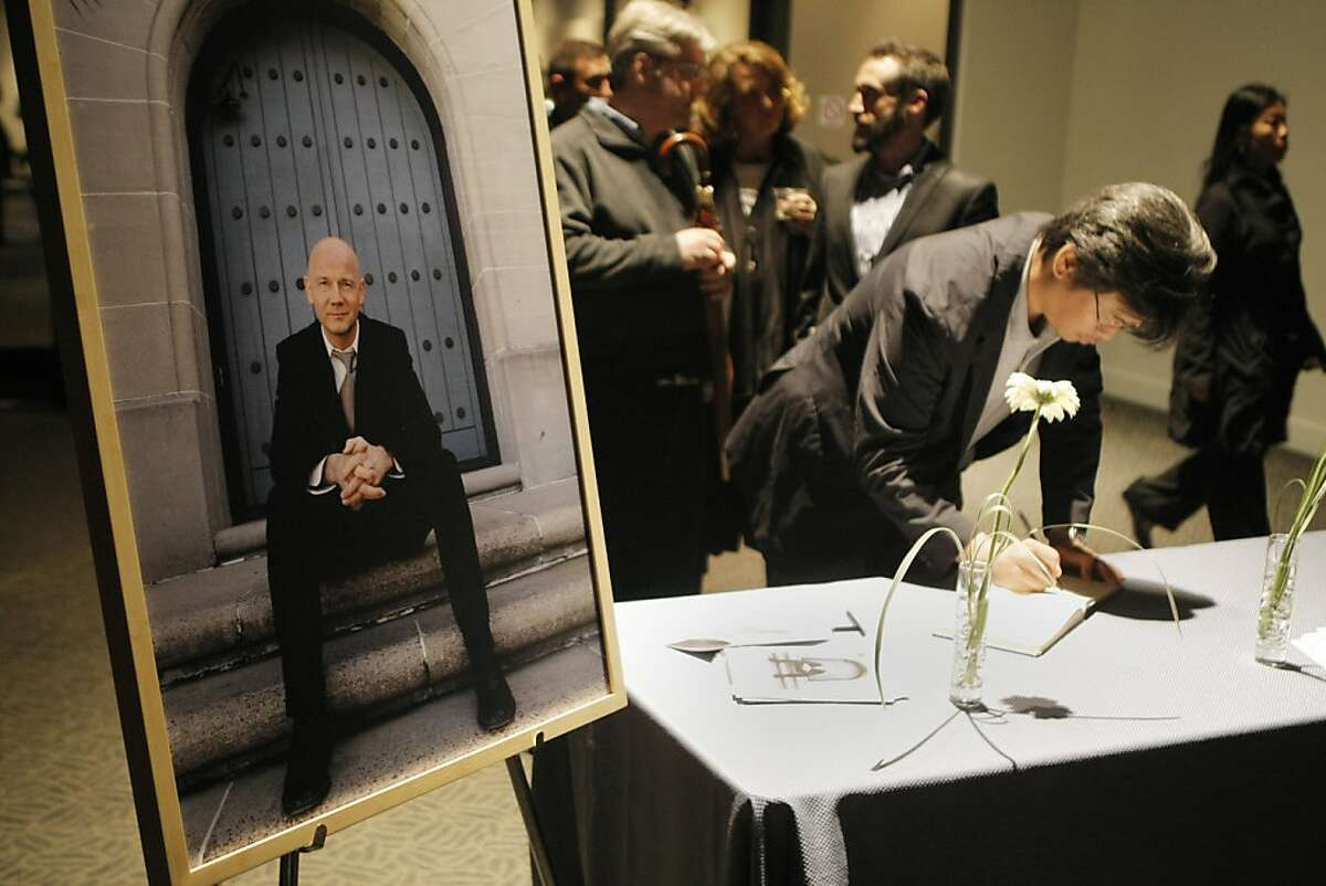 Guests leave well wishes during a memorial for Graham Leggat, former Executive Director of the San Francisco Film Society, at the Palace of Fine Arts in San Francisco, Calif., on Tuesday, Oct. 4, 2011. Leggat passed away in late August after an eighteen month battle with cancer; he is pictured at left.