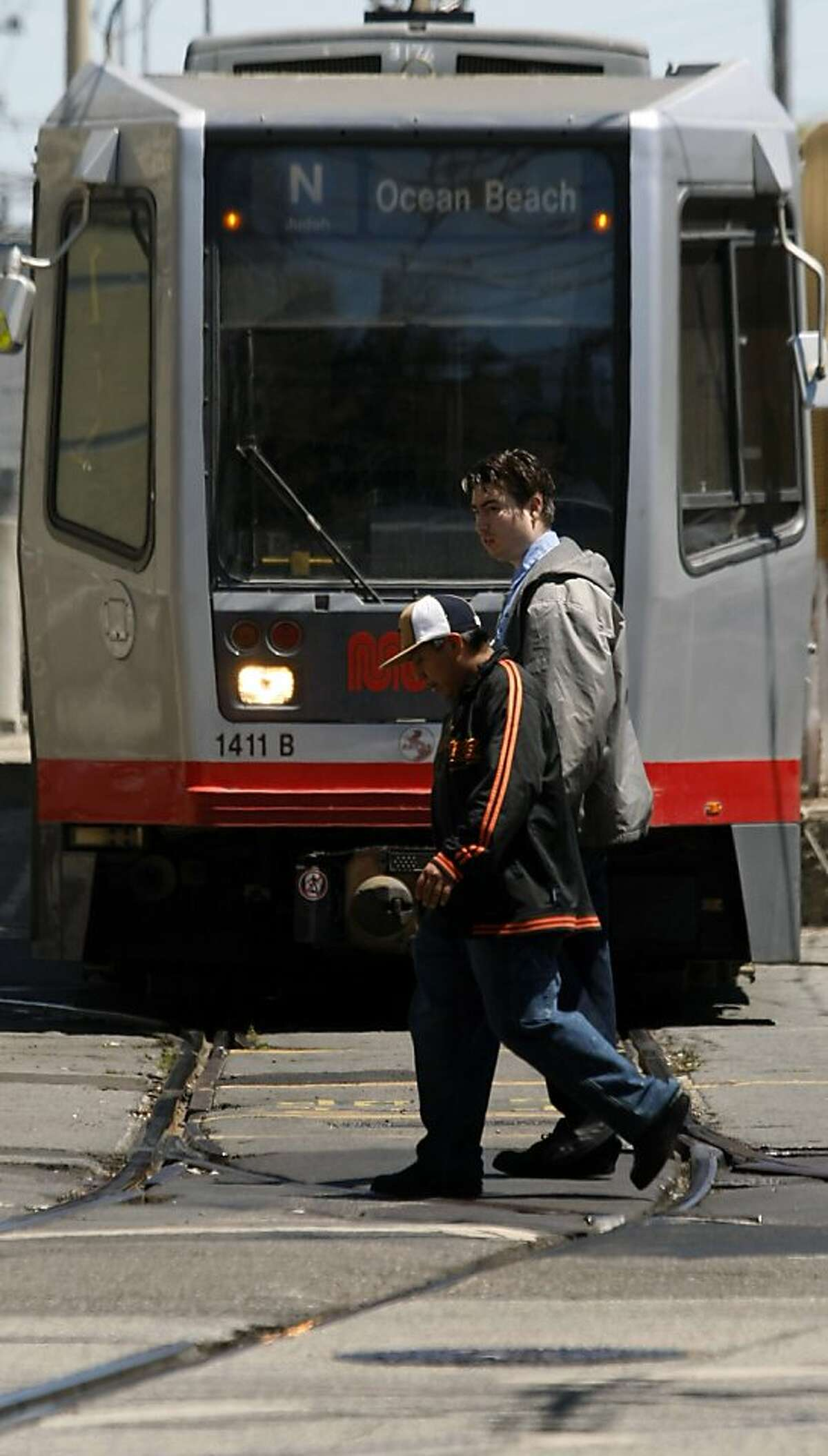 A MUNI light rail train emerges from a tunnel onto Duboce Street at Church in San Francisco Tuesday August 4, 2009
