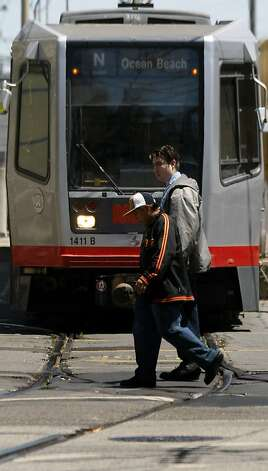 A MUNI light rail train emerges from a tunnel onto Duboce Street at Church in San Francisco Tuesday August 4, 2009 Photo: Lance Iversen, The Chronicle