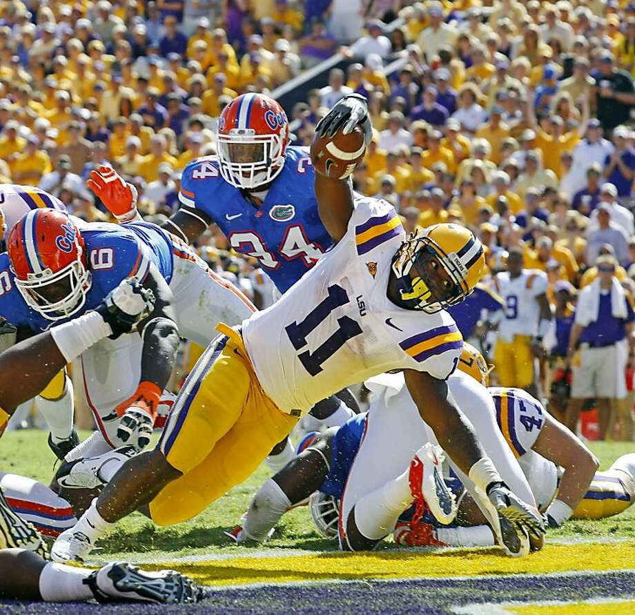 LSU running back Spencer Ware (11) dives into the end zone for a touchdown against Florida in the first half of an NCAA college football game in Baton Rouge, La., Saturday, Oct.  8, 2011. (AP Photo/Bill Haber) Photo: Bill Haber, AP