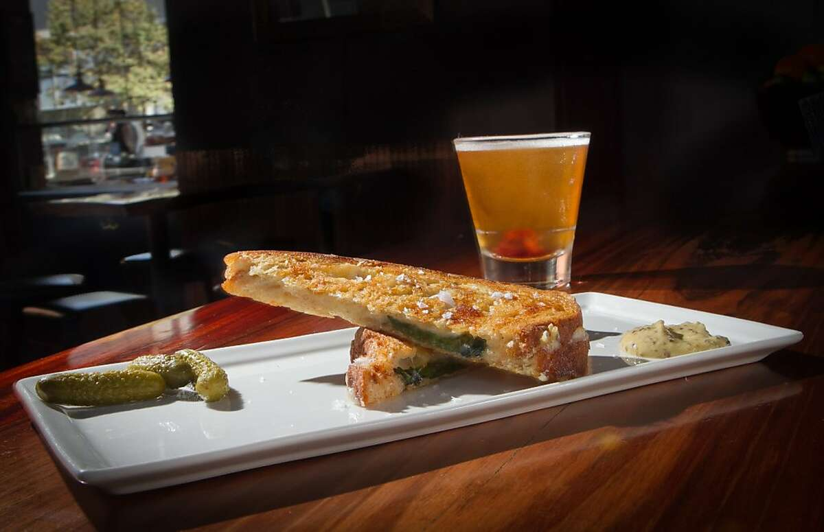 """The Grilled Cheese sandwich with White Cheddar, Mozzarella and Basil and the """"Brooklyn"""" at the Dogwood Bar in Oakland, Calif., is seen on Friday, September 30th, 2011."""