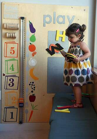 India Berlin, 2 and a half years old, playing at one of the new Play-to-Learn interactive walls of Potrero Branch Library in San Francisco, California, on Friday, September 23, 2011. Photo: Liz Hafalia, The Chronicle