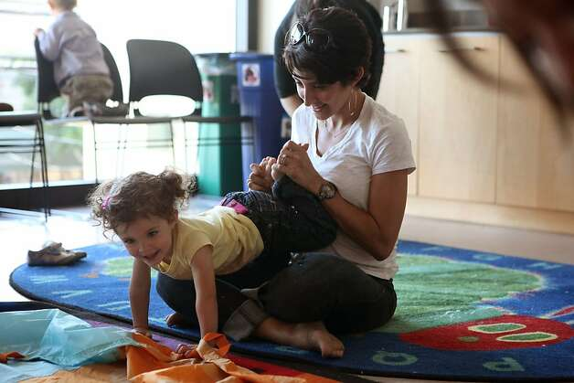 Alexandra Zappacosta playing with her 2 year old Sofia Zappacosta at the Potrero Branch Library in San Francisco, California, in their toddler play group on Friday, September 23, 2011. Photo: Liz Hafalia, The Chronicle