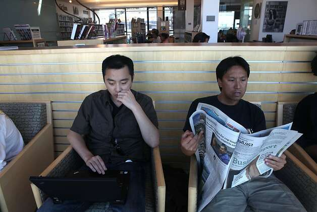 Irwin Kwong (left), from San Francisco,on his computer and Tod Hing (right), from San Francisco, reading the Chronicle at Potrero Branch Library in San Francisco, California, on Friday, September 23, 2011.  Where they are seated has a great view toward the downtown and bridge areas. Photo: Liz Hafalia, The Chronicle