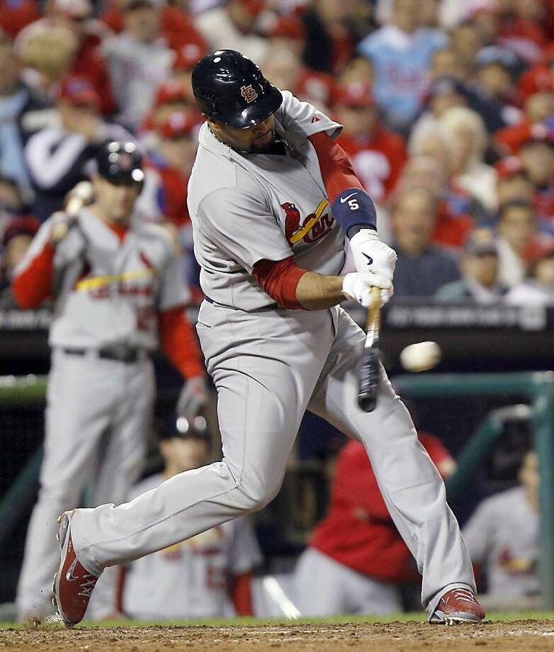 St. Louis Cardinals' Albert Pujols (5) hits an RBI single during the seventh inning of baseball's Game 2 of the National League division series with the Philadelphia Phillies Sunday, Oct. 2, 2011 in Philadelphia. (AP Photo/Matt Rourke) Photo: Matt Rourke, AP
