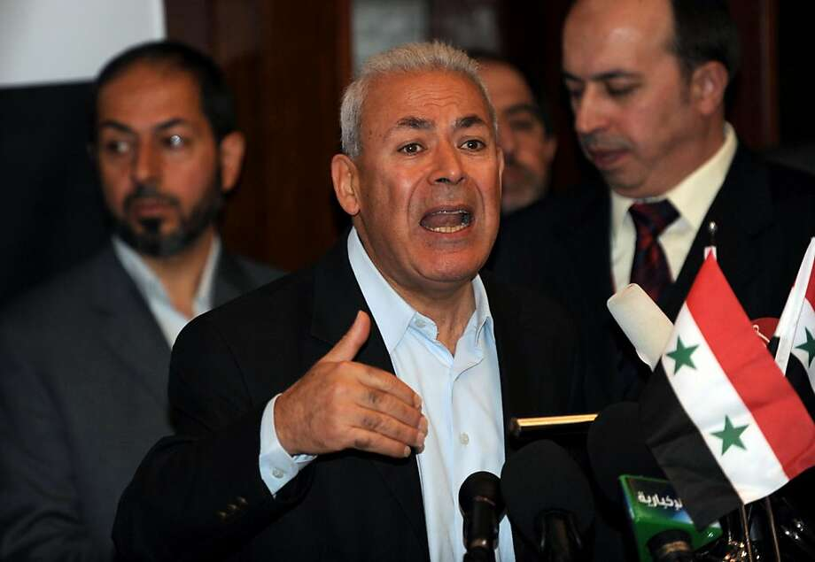 """One of Syria's opposition leaders, Burhan Galion, speaks during a press conference following a gathering of Syrian opposition leaders and activists in Istanbul, on October 2, 2011. Syrian opposition groups meeting in Turkey on October 2 formed a """"historic"""" united common front against President Bashar al-Assad's regime as his crackdown on dissent showed no sign of easing. AFP PHOTO / BULENT KILIC (Photo credit should read BULENT KILIC/AFP/Getty Images) Photo: Bulent Kilic, AFP/Getty Images"""