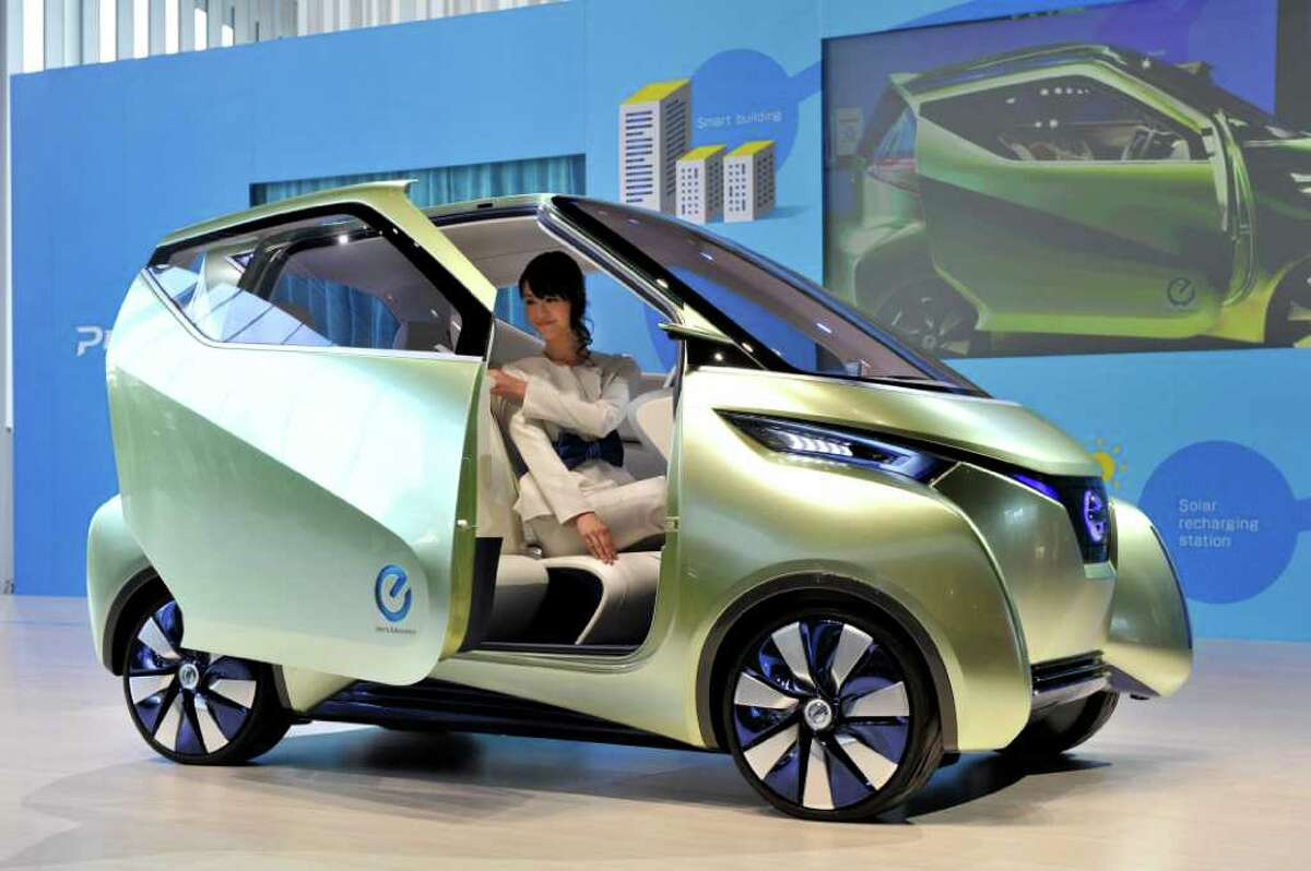 Japan's auto giant Nissan Motor displays a concept model of the smart urban commuter