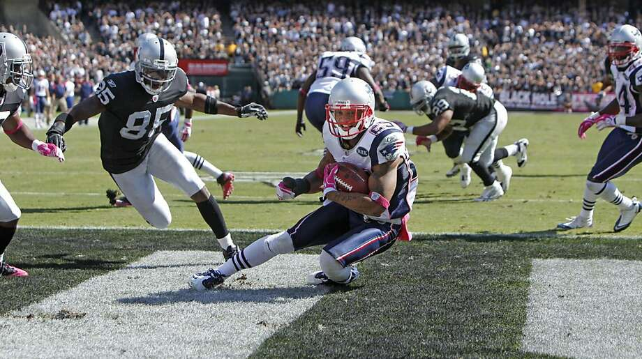 New England Patriots Patrick Chung turns after intercepting Raiders Jason Campbell's throw on the goal line and makes a touchback  in the second quarter, Sunday Oct. 2, 2011, at the O.com Coliseum in Oakland, Calif. The Patriots defeated the Raiders 31-19. Photo: Lacy Atkins, The Chronicle