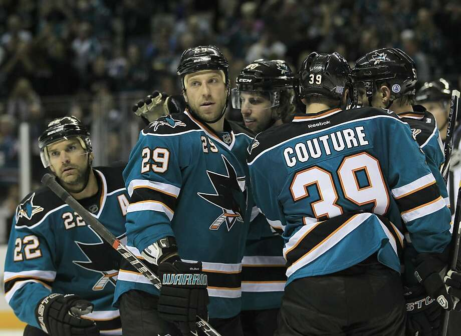 San Jose Sharks right wing Ryane Clowe (29) celebrates with Logan Couture (39) and Dan Boyle (22) after scoring against the Phoenix Coyotes during the second period in an NHL hockey game, Saturday, Oct. 8, 2011, in San Jose, Calif. (AP Photo/Tony Avelar) Photo: Tony Avelar, AP