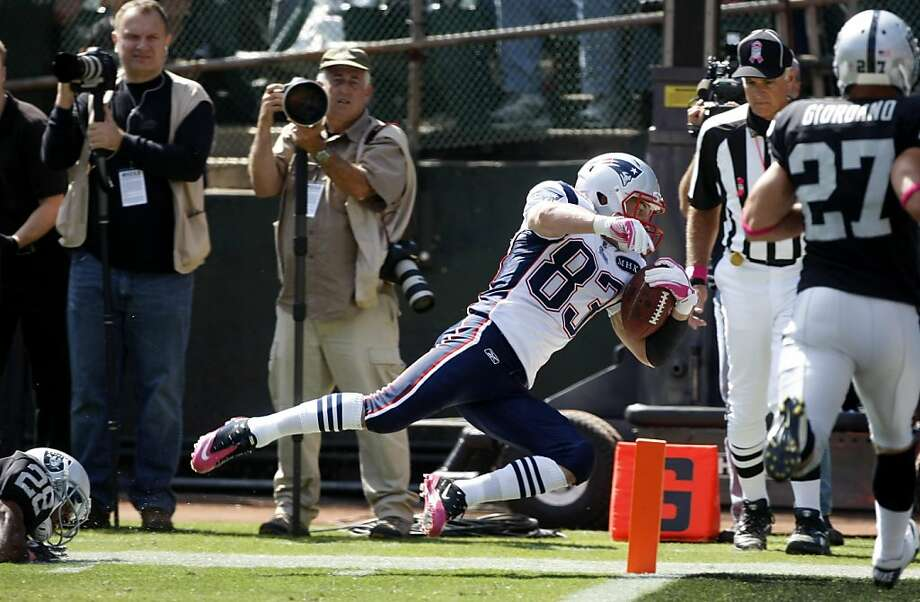 The New England Patriots wide receiver Wes Welker scores against the Oakland Raiders in the first quarter, Sunday Oct. 2, 2011, at the O.com Coliseum in Oakland, Calif. The Patriots defeated the Raiders  31-19. Photo: Lacy Atkins, The Chronicle