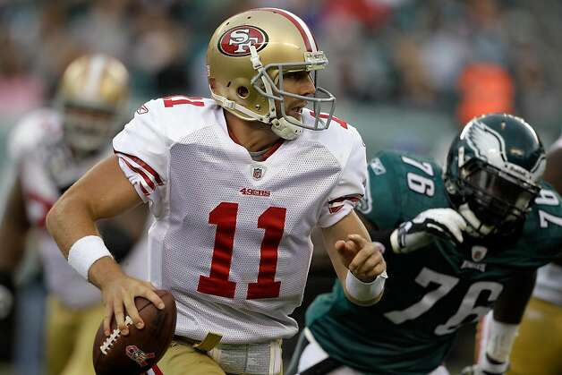 PHILADELPHIA, PA - OCTOBER 02: Quarterback  Alex Smith #11 of the San Francisco 49ers is pressured by defender  Phillip Hunt #76 of the Philadelphia Eagles during the second half at Lincoln Financial Field on October 2, 2011 in Philadelphia, Pennsylvania.  The 49ers defeated the Eagles 24-23. (Photo by Rob Carr/Getty Images) Photo: Rob Carr, Getty Images