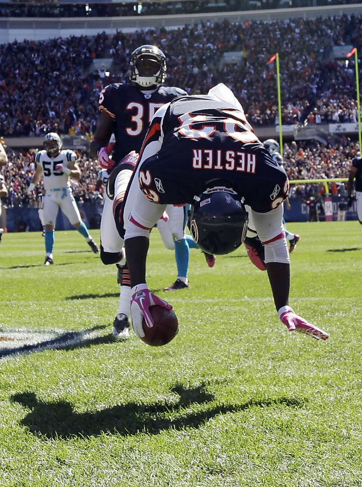 Chicago Bears wide receiver Devin Hester (23) flips in the end zone after returning a punt 69 yards for a touchdown against the Carolina Panthers in the first half of an NFL football game in Chicago, Sunday, Oct. 2, 2011. (AP Photo/Nam Y. Huh)