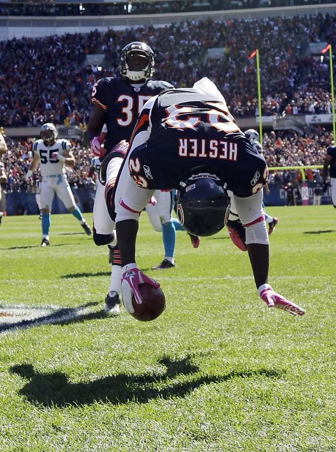 Chicago Bears wide receiver Devin Hester (23) flips in the end zone after returning a punt 69 yards for a touchdown against the Carolina Panthers in the first half of an NFL football game in Chicago, Sunday, Oct. 2, 2011. (AP Photo/Nam Y. Huh) Photo: Nam Y. Huh, AP