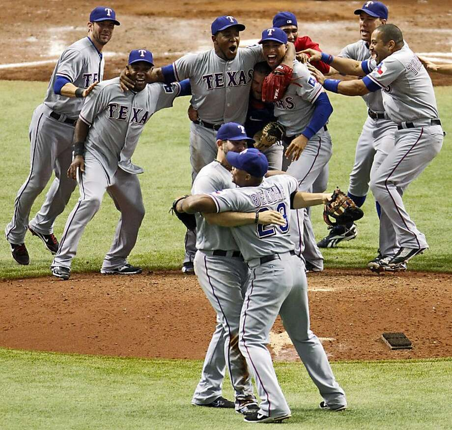 Members of the Texas Rangers celebrate their 4-3 win over the Tampa Bay Rays in Game 4 of baseball's American League division series, Tuesday, Oct. 4, 2011, in St. Petersburg, Fla. The victory gave the Rangers a 3-1 series win. (AP Photo/Mike Carlson) Photo: Mike Carlson, AP